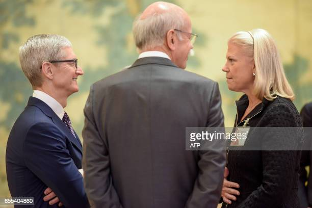 Apple CEO Tim Cook talks with Chairwoman President and CEO of IBM Ginni Rometty and CEO of Daimler AG Dieter Zetsche before a meeting with Chinese...