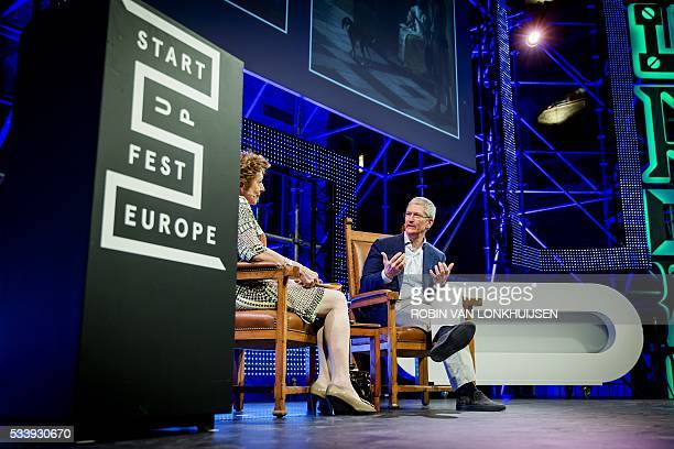Apple CEO Tim Cook talks with Dutch businesswoman, former politician and European commissioner, Neelie Kroes , during the StartupDelta at the Startup...