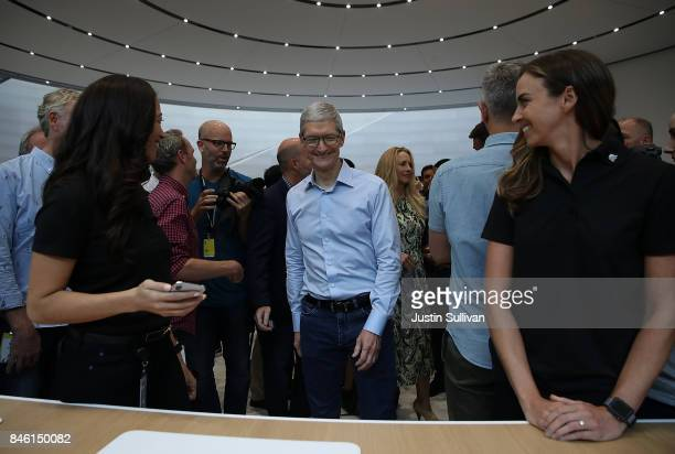 Apple CEO Tim Cook tours the display area during an Apple special event at the Steve Jobs Theatre on the Apple Park campus on September 12 2017 in...