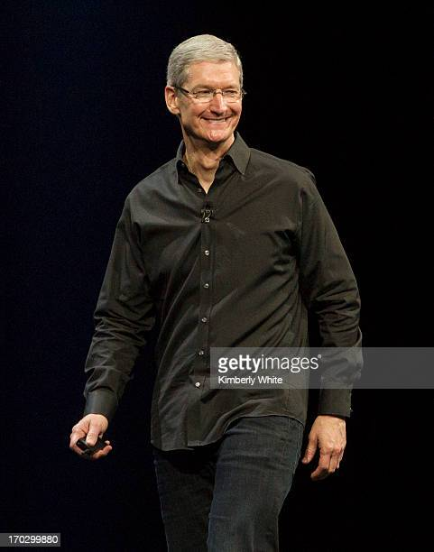 Apple CEO Tim Cook waves during the keynote address during the 2013 Apple Apple Worldwide Developers Conference at the Moscone Center on June 10,...