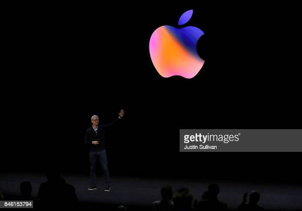 Apple CEO Tim Cook waves to the audience during an Apple special event at the Steve Jobs Theatre on the Apple Park campus on September 12 2017 in...
