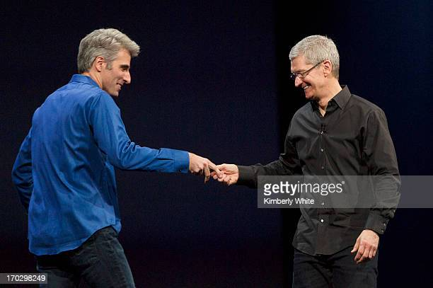 Apple CEO Tim Cook welcomes Craig Federighi, vice president of Software Engineering, on stage during a keynote address during the 2013 Apple WWDC at...