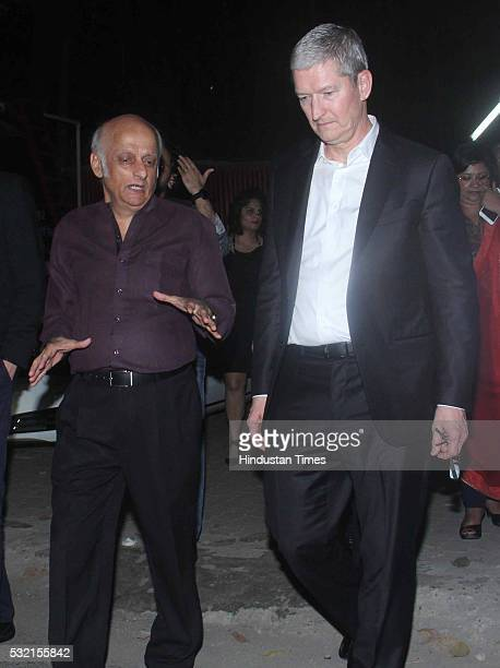 Apple CEO Tim Cook with Bollywood filmmaker Mukesh Bhatt at Mehboob Studio Bandra on May 18 2016 in Mumbai India Apple CEO Tim Cook and COO Jeff...
