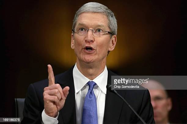 Apple CEO Timothy Cook delivers opening remarks while testifying before the Senate Homeland Security and Governmental Affairs Committee's...