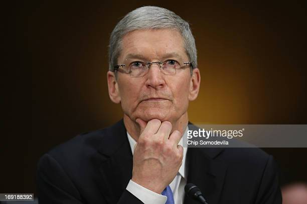 Apple CEO Timothy Cook delivers pauses while giving opening remarks while testifying before the Senate Homeland Security and Governmental Affairs...