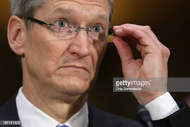 Apple CEO Timothy Cook testifies before the Senate Homeland Security and Governmental Affairs Committee's Investigations Subcommittee about the...