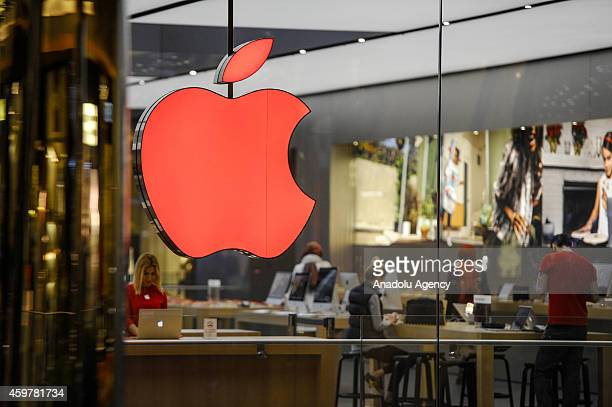 Apple changes the color of its logo to red in Istanbul Turkey to show its support on World AIDS day on December 1 2014 Apple will be hosting a...