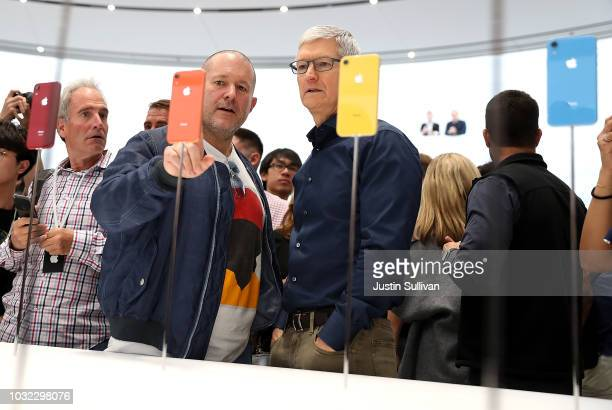 Apple chief design officer Jony Ive and Apple CEO Tim Cook inspect the new iPhone X R during an Apple special event at the Steve Jobs Theatre on...