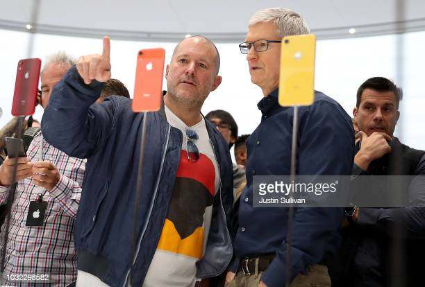 Apple chief design officer Jony Ive and Apple CEO Tim Cook inspect the new iPhone XR during an Apple special event at the Steve Jobs Theatre on...