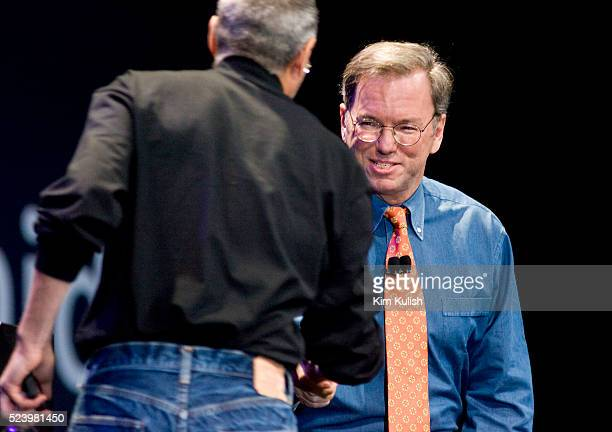 Apple Chief Executive Officer Steve Jobs greets Eric Schmidt chief executive officer of Google during the introduction of the iPhone in San Francisco...