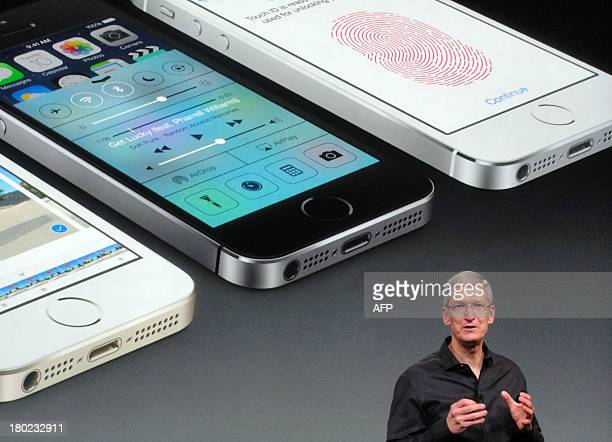 Apple chief executive Tim Cook praises the new iPhone 5S as the most refined model the company has ever introduced on September 10, 2013 in...
