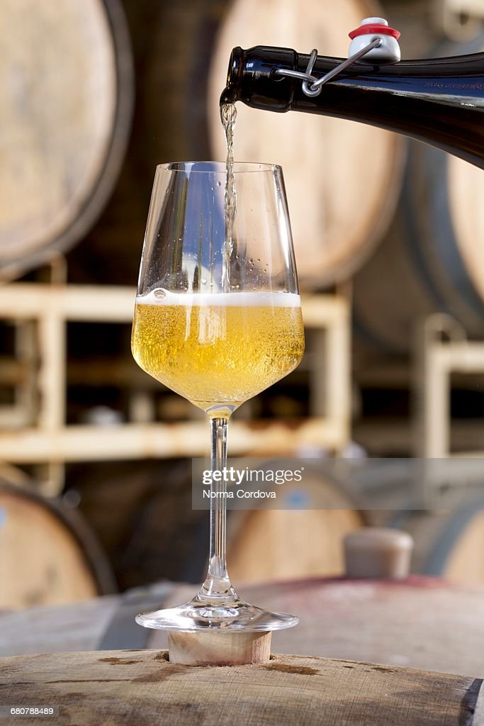 Apple cider being poured into glass : Stock Photo