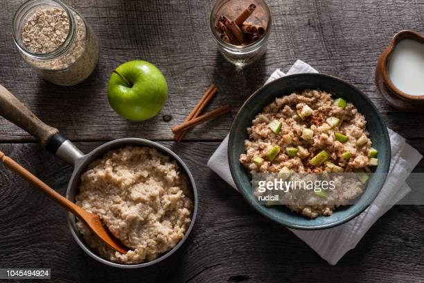 apple cinnamon oatmeal - oatmeal stock pictures, royalty-free photos & images