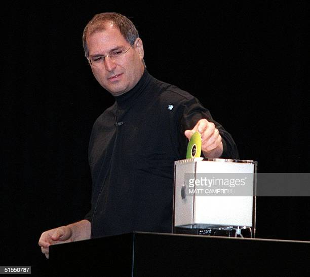 Apple Computer CEO Steve Jobs demonstrates the DVD drive in the new Apple G4 Cube during the keynote speech at the Macworld Conference 19 July 2000...