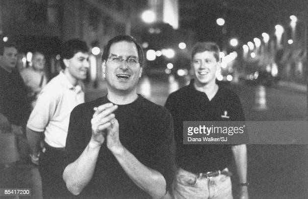 Apple Computer CEO Steve Jobs in Boston, after negotiating an Apple alliance w. Microsoft. Apple colleagues in the background, including Jim Oliver,...