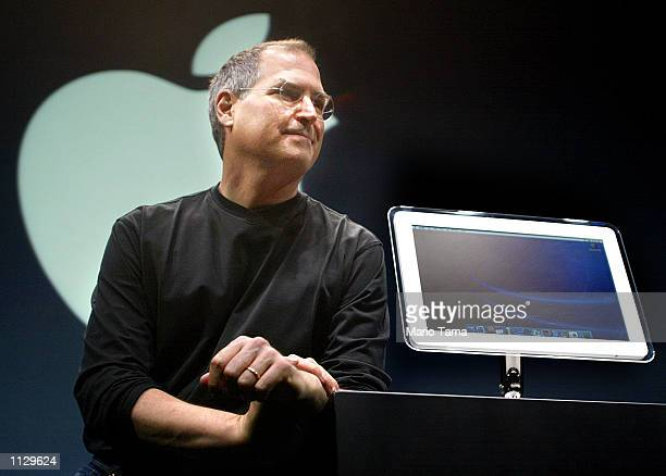 Apple Computer CEO Steve Jobs stands next to a new version of the iMac computer featuring a 17 inch monitor at Macworld Conference and Expo July 17...