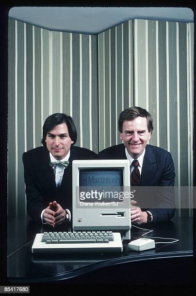 Apple Computer founder Steve Jobs CEO and chairman John Sculley posing with Macintosh computer in New York City in 1984 IMAGES PREVIOUSLY A PART OF...