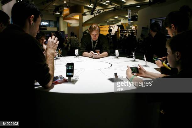 Apple consumers explore the features of various iPhone and iPod models during the Macworld Expo 2009 in San Francisco CA Wednesday January 7 2009...