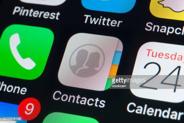 apple contacts, calendar,phone and other apps on iphone screen - calendar icon stock photos and pictures