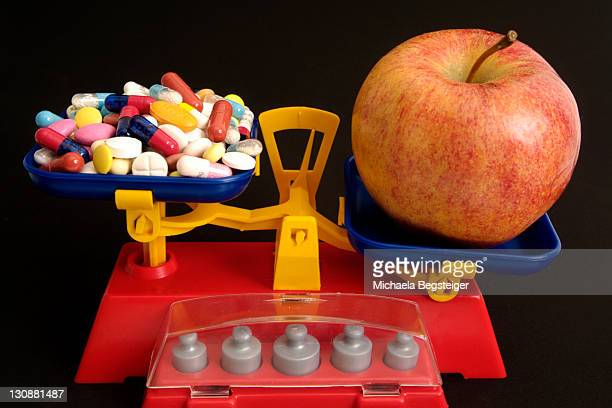 Apple contra vitamine pills