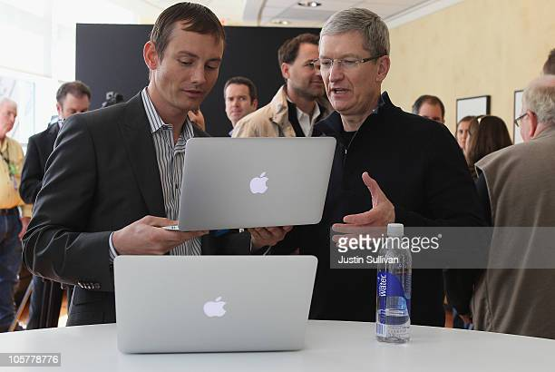 Apple COOTim Cook looks at the new MacBook Air during an Apple special event at the company's headquarters on October 20 2010 in Cupertino California...