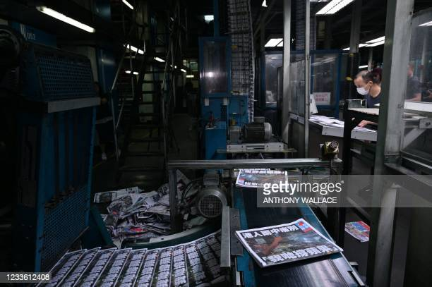 Apple Daily employees work in the printing room for the next days paper, for what was announced the previous day to be for the last time, in Hong...