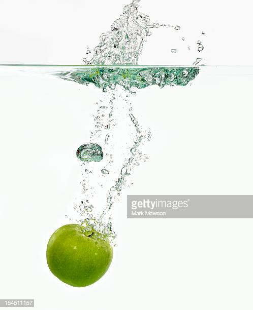 Apple dropping in water