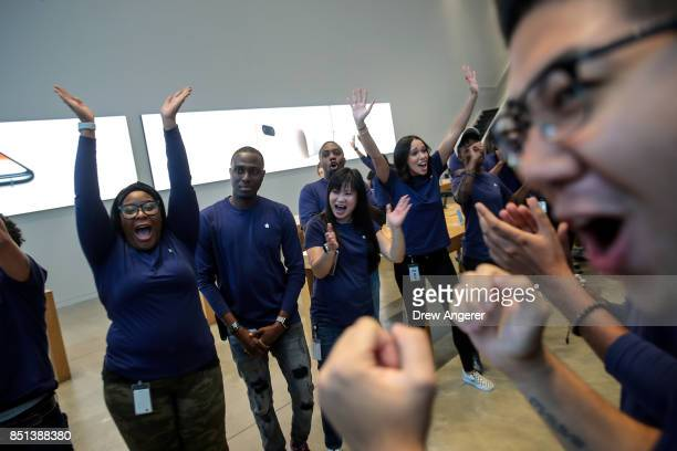 Apple employees cheer as the doors are opened for customers at the Fifth Avenue Apple Store September 22 2017 in New York City The new iPhone 8 and...
