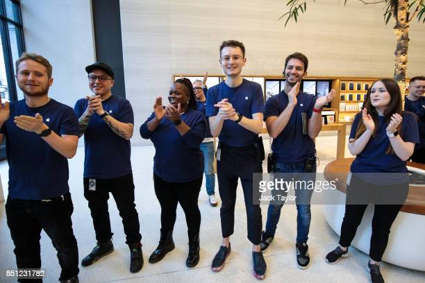 Apple employees clap as customers arrive at Apple Regent Street for the launch of the iPhone 8 on September 22 2017 in London England Apple have...