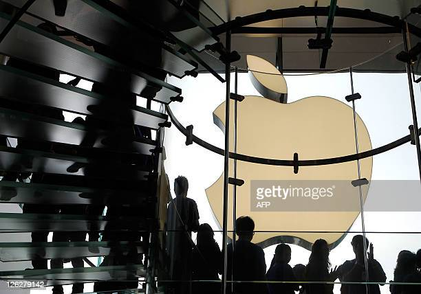 Apple employees line the stairs as they welcome customers during the opening of the first Apple retail store in Hong Kong on September 24 2011 Apple...
