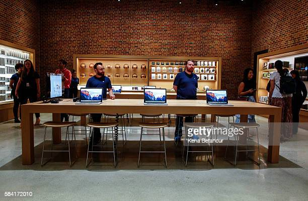 Apple employees stand in the new Brooklyn Apple Store during a media preview in the Williamsburg neighborhood of Brooklyn on July 28 2016 in New York...