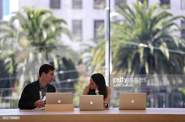 Apple employees work on laptops in 'The Forum' inside the new flagship Apple Store on May 19 2016 in San Francisco California Apple is preparing to...