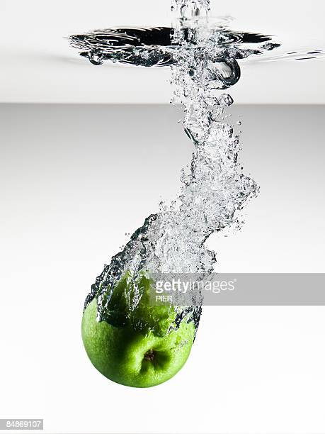 Apple falling into water