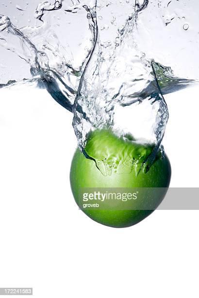 Apple falling through water