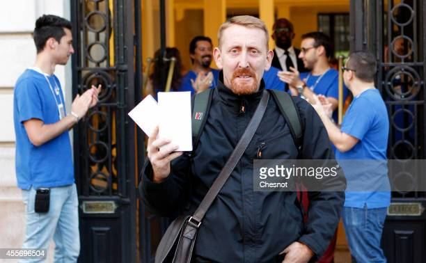 Apple Fan Sylvain from Paris holds up the first iPhone 6's purchased at the Apple store Opera on September 19 in Paris France Apple says more than...