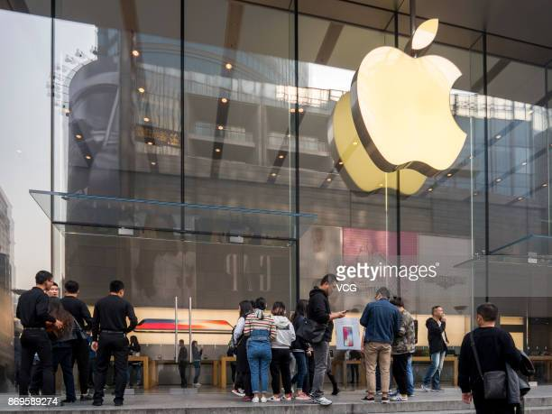 Apple fans arrive at an Apple store on Nanjing East Road to buy iPhone X on November 3 2017 in Shanghai China iPhone X go on sale on Friday and...