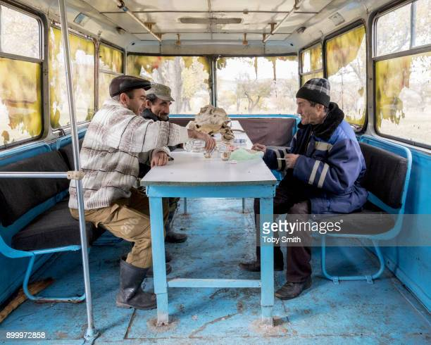 Apple farmers take a break near an orchard on the banks of the River Akhurian Climate change has reduced the seasonal water availability of the river...