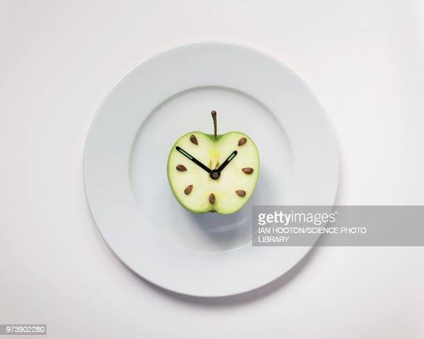 apple half with clock hands - time stock pictures, royalty-free photos & images