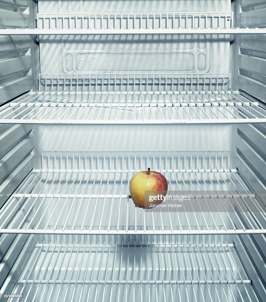 Apple in a Fridge : Stock Photo
