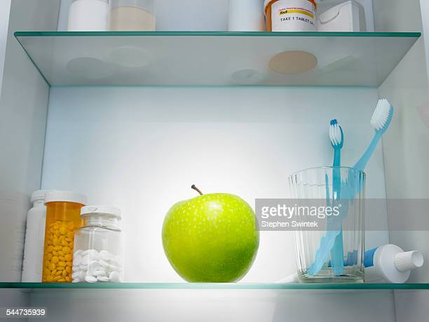 Apple in a medicine cabinet