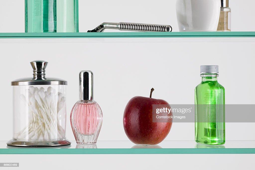 Apple in a medicine cabinet : Stock Photo