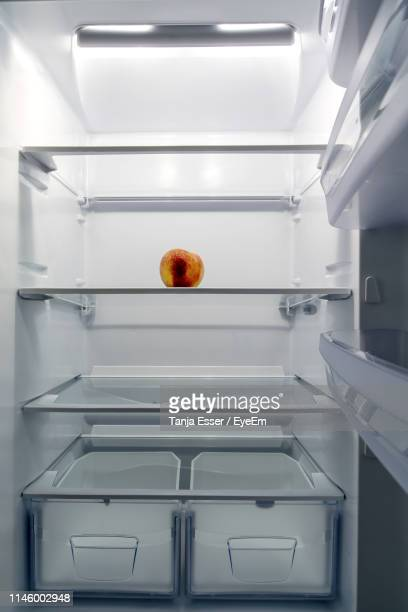 apple in refrigerator - refrigerator stock pictures, royalty-free photos & images