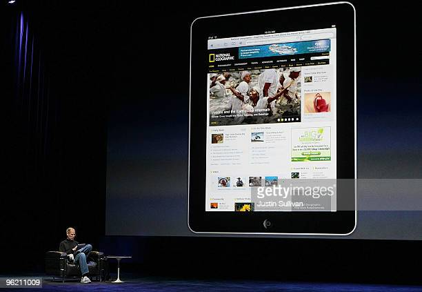 Apple Inc. CEO Steve Jobs demonstrates the new iPad as he speaks during an Apple Special Event at Yerba Buena Center for the Arts January 27, 2010 in...