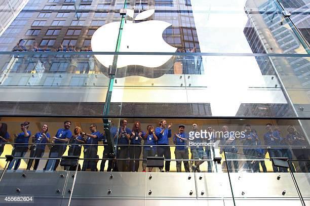 Apple Inc employees cheer before opening the doors to the company's George Street store for the sales launch of the iPhone 6 and iPhone 6 Plus in...