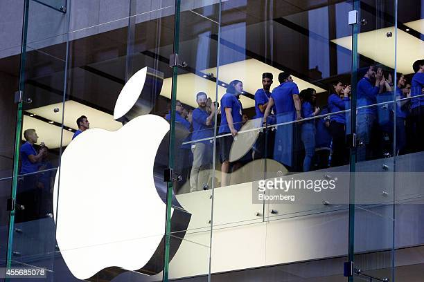 Apple Inc. Employees cheer before opening the doors to the company's George Street store for the sales launch of the iPhone 6 and iPhone 6 Plus in...