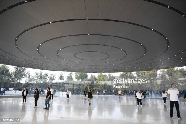 Apple Inc employees stand as attendees arrive ahead of an event at the Steve Jobs Theater in Cupertino California US on Tuesday Sept 12 2017 Apple...