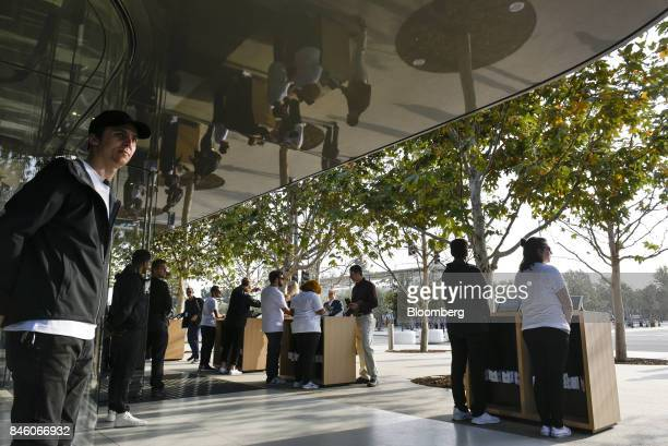 Apple Inc employees wait to checkin attendees ahead of an event at the Steve Jobs Theater in Cupertino California US on Tuesday Sept 12 2017 Apple...