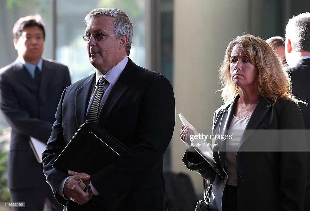 Apple Inc. general counsel Bruce Sewell (L) prepares to enter the Robert F. Peckham Federal Courthouse on July 30, 2012 in San Jose, California. The trial in the Apple Inc. and Samsung Electronics Co. patent battle begins today at a San Jose federal courthouse to determine if Samsung illegally copied technolgy used in Apple's popular iPhone and iPads. Apple is seeking $2.5 billion in damages.