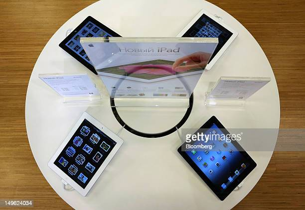 Apple Inc iPad tablet computers sit on display inside a reStore a premium Apple product reseller in Moscow Russia on Wednesday Aug 1 2012 OAO Mobile...