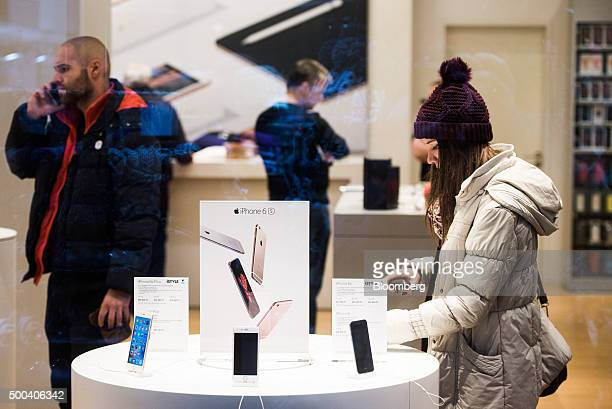 Apple Inc iPhone 6 smartphones sit on display inside an Apple store as shoppers browse in Budapest Hungary on Saturday Dec 5 2015 Hungary GDP growth...